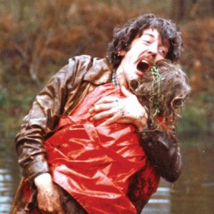 a man wails with horror as he pulls his daughters body from a pond