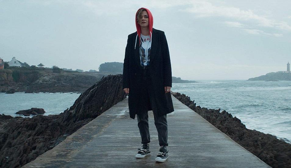 Emma Larismon stands on a pier looking concerned