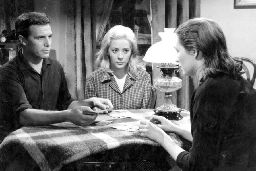 Jorge (Francisco Rabal), Ramona (Margarita Lozano), and Viridiana (Silvia Pinal) play cards.