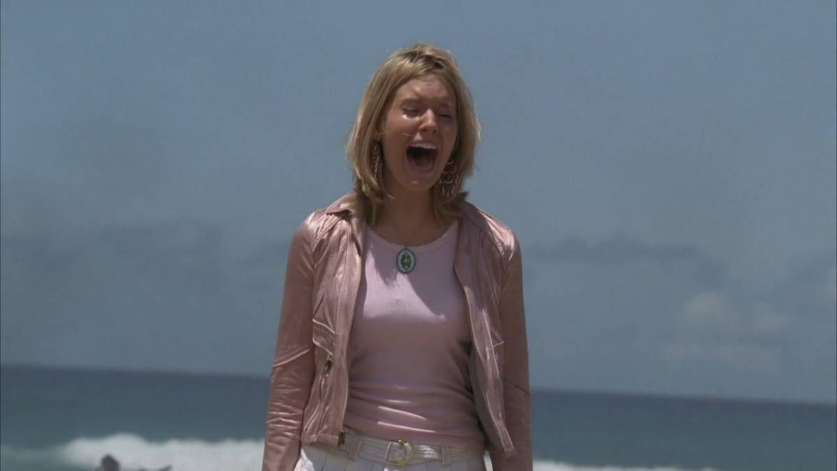 Shannon screams on the beach after the plane crash