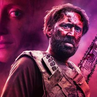 Nic Cage armed and bathed in purple. his girlfrend Mandy's image behind him