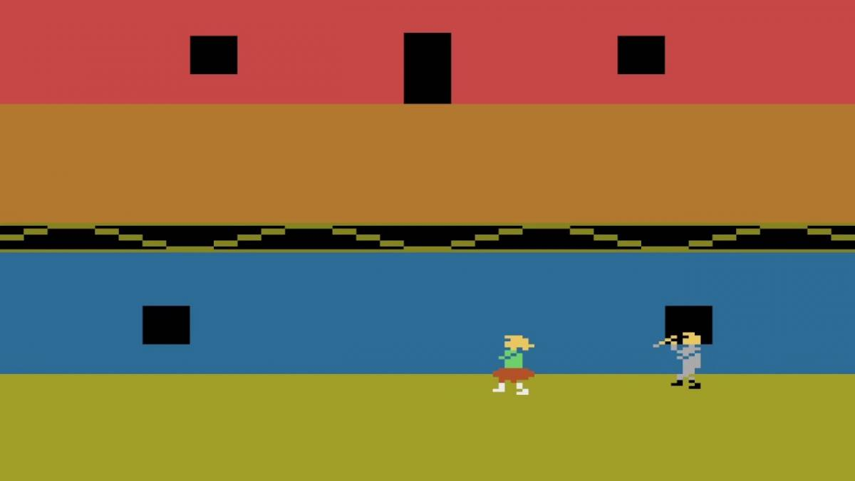 An 8 bit screen shows a killer chasing a babysitter in dated graphics