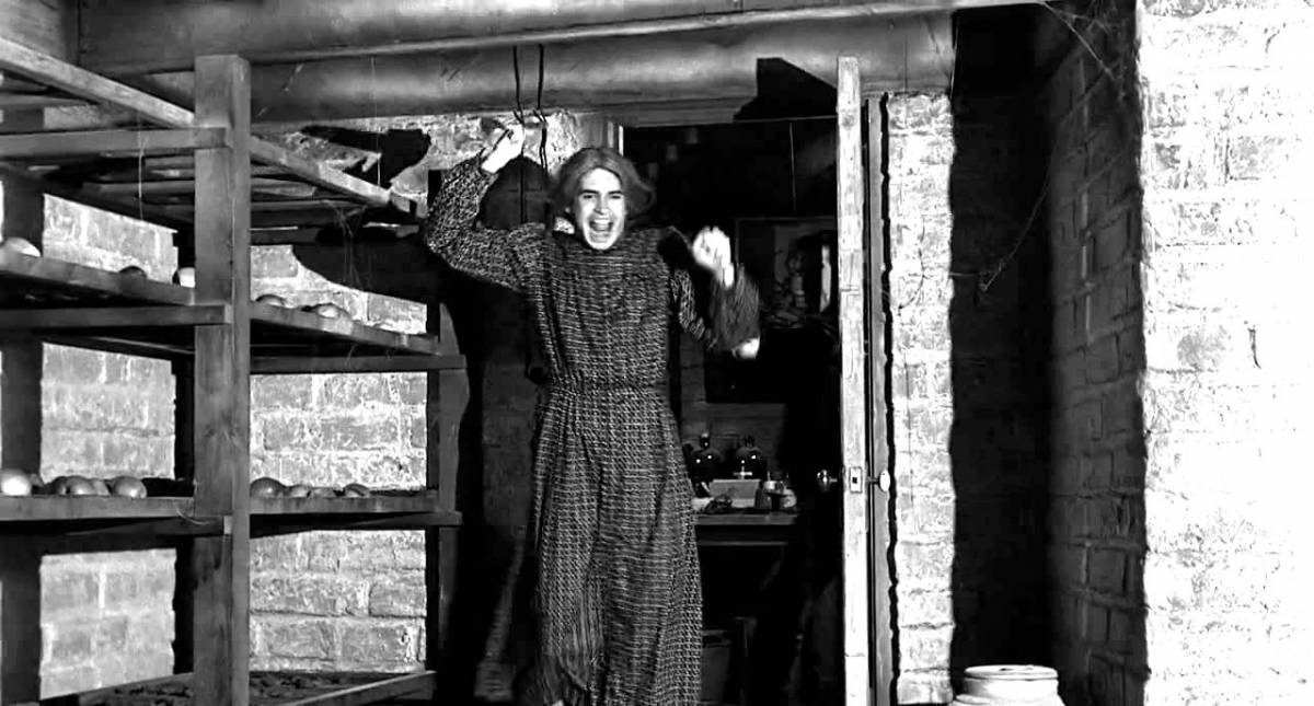 Norman Bates dressed as his mother wielding a knife