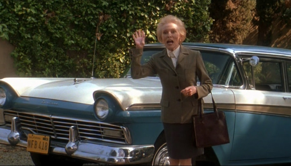 Janet Leigh as Norma Watson in Halloween: H20, waving and standing by her car, the same as in the film Psycho
