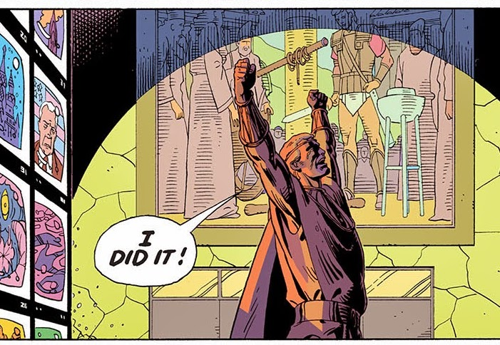 Image of Ozymandias standing in front of television screens in DC Comic yelling triumphantly, I did it!