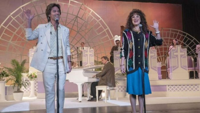 Baby Billy (Walton Goggins) and his sister Aimee-Leigh (Jennifer Nettles) perform in font of at crowd in a flashback to the '80s.