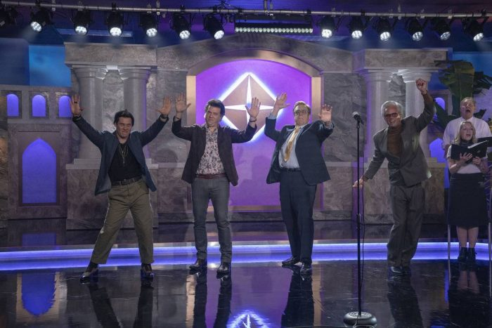 Kelvin (Adam Devine), Jesse (Danny McBride), Eli (John Goodman) and Baby Billy (Walton Goggins) perform in their new mall church alongside a choir, in front of an extravagant temple backdrop.
