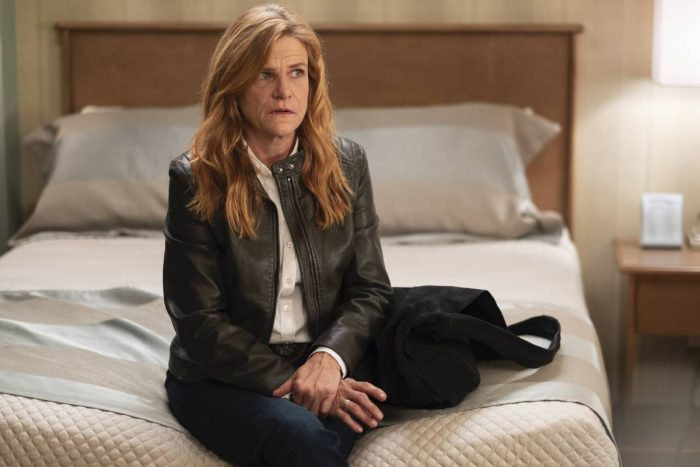 Sharon (Dale Dickey) sits on the bed in Room 104