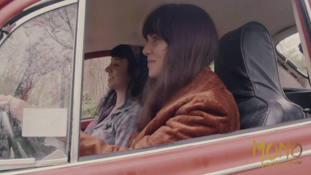 Elizabeth Saint and Sara Heddleston taking a joy ride in Momo: the Missouri Monster