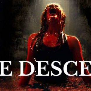 A woman bathed in blood, standing in a pool of blood screaming