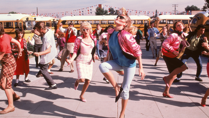 "The Pink Ladies, lead by Stephanie ((Michelle Pfeiffer) dance outside school in the opening number ""Back to School"" in Grease 2."