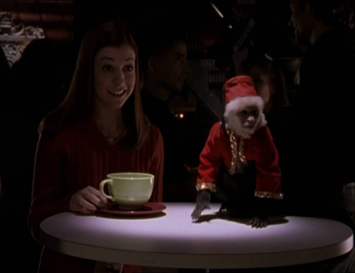 Willow sits at a table with a monkey.