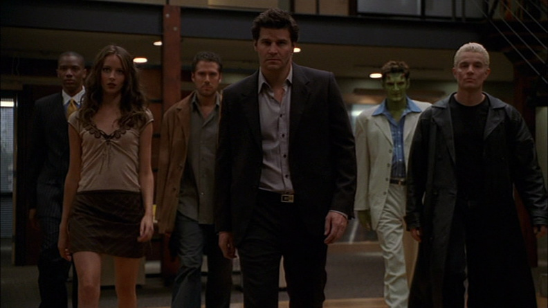 Team Angel collectively walks toward the camera, with great intent.