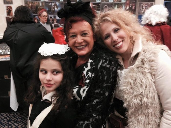 Gracie (Cat Smith's daughter), Patricia Quinn, and Cat Smith all pose for a photo together at con.
