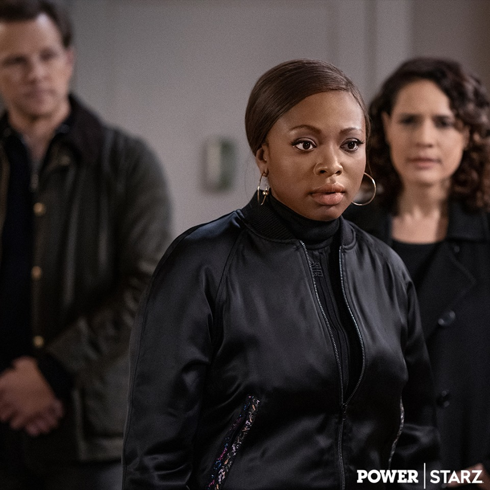 Tasha looks concerned as she has her back to the federal agents Blanca and Saxe