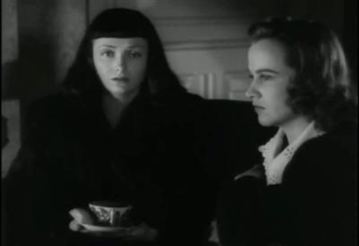 Mary (Kim Hunter) and Jacqueline (Jean Brooks) sitting and thinking, partly in shadow