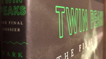 The cover of the Final Dossier at an angle to show the title both on its spine and its front cover.