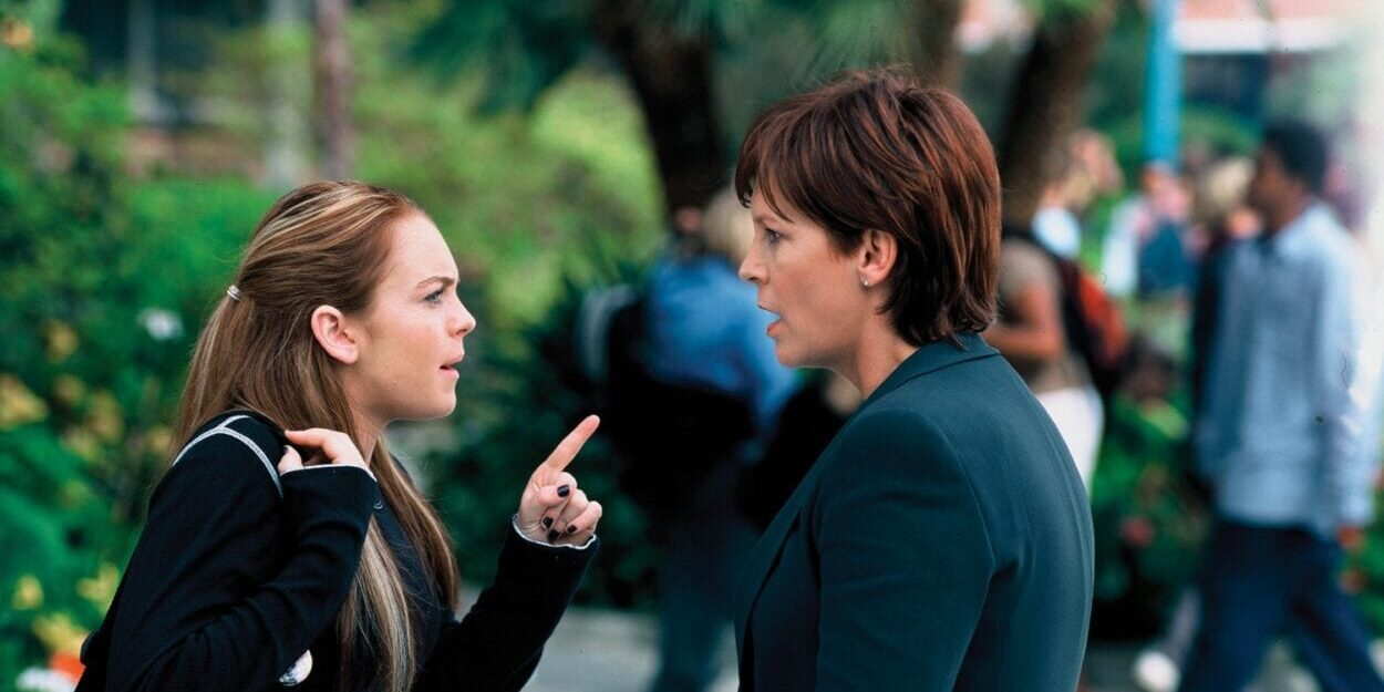 Anna and Tess, having switched bodies, argue outside Anna's school