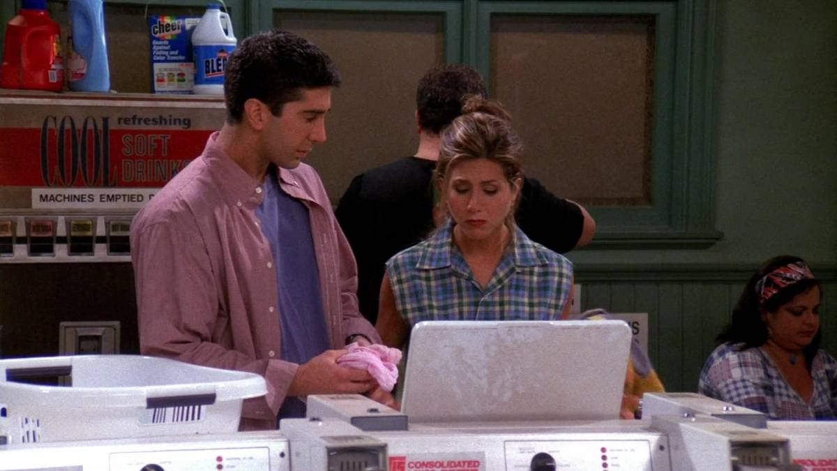 Ross and Rachel look into the washing machine at the laundromat, seeing how every item of her clothes is now pink.
