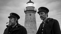 Thomas (left) and Ephram (right) stare at their departing ship in front of their lighthouse post.