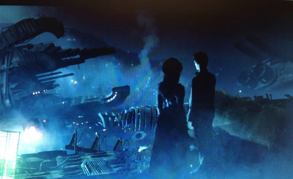 The 11th Doctor and Idris look out over the junkyard of broken TARDISes