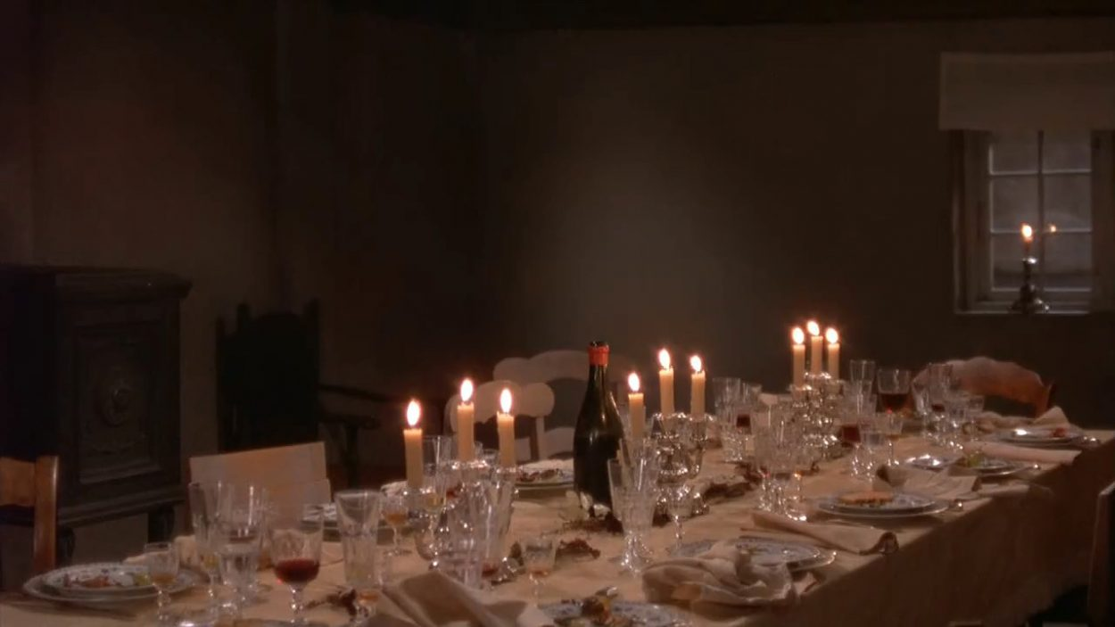 The camera focuses on the unset dinner table of Babette's Feast.