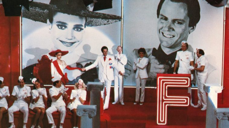 Farley Flavors take Janet Major's hand on an episode of Faith Factory in Shock Treatment