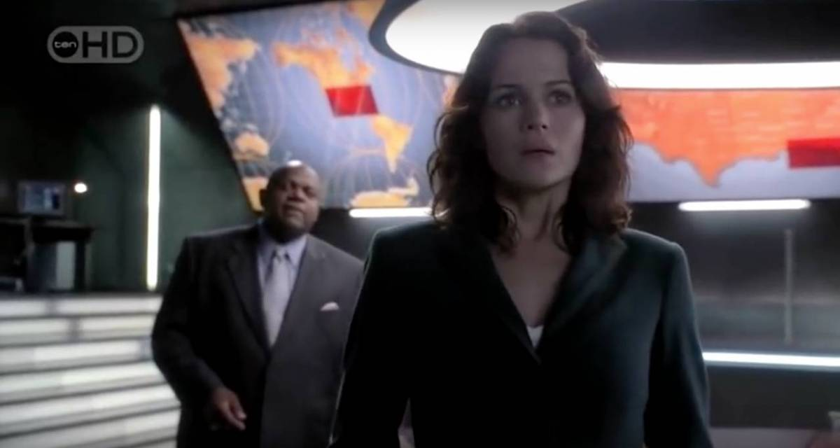 Molly (Carla Gugino) struggles with a decision in a scene from Threshold.