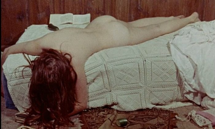 Therese philosophe lying naked facedown on a bed, head lolling off the side