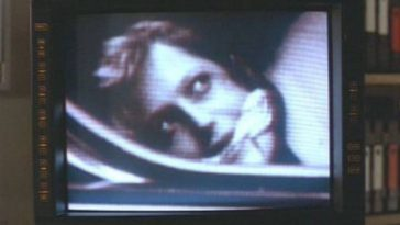 a security screen shows a close-up image of a gagged Dana Scully in the trunk of a car.