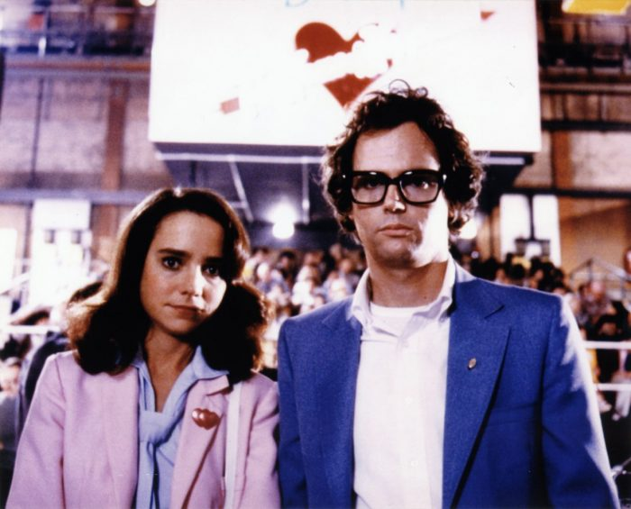 "Janet (Jessica Harper) and Brad Majors (Cliff De Young) stand in from of the Denton Home of Happiness sign in ""Shock Treatment"""