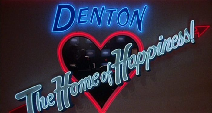 "The Neon Home of Happiness sign glows in ""Shock Treatment"""