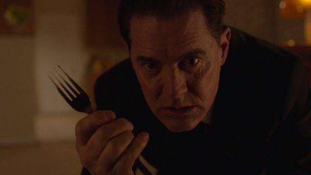 Dougie Jones seems to be Dale Cooper again, crawling across the floor slowly with Fork in hand.