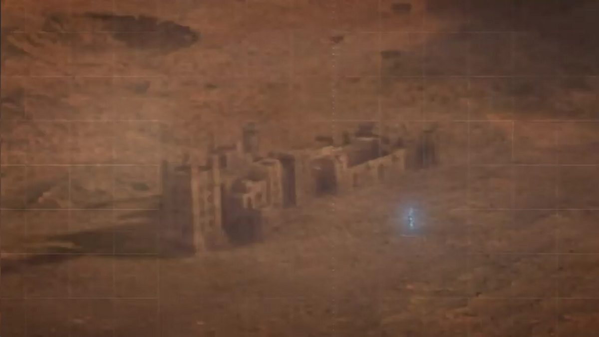 Dr Manhattan stands in front of a castle-like structure on Mars
