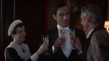 The Lord of a Country Estate proposes a toast with his butler and maid