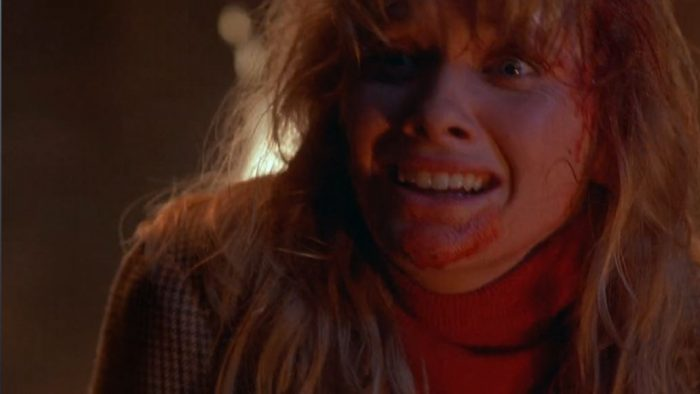 Barbara Crampton is staring wide-eyed at the end of From Beyond