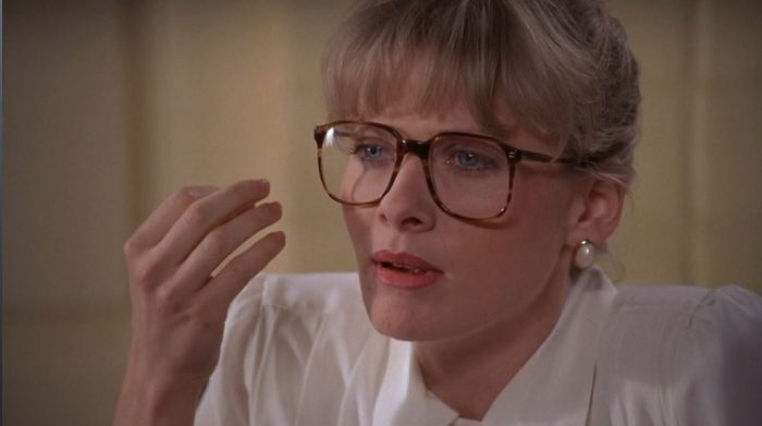 Barbara Crampton puts her hand to her face in Dr. Pretorius' kitchen in From Beyond