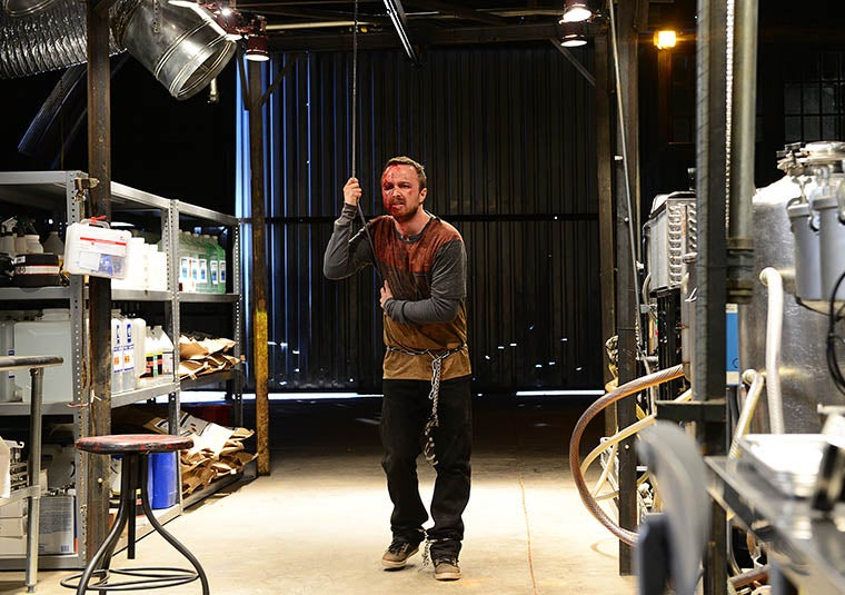 A bloodied Jesse Pinkman is chained up in the Nazis' meth lab