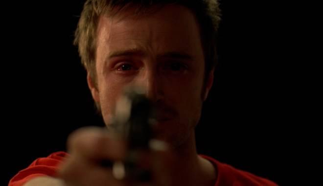 Jesse tears up as he points a gun towards Gale Boetticher