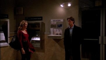 Model Jill Goodacre is in a locked ATM vestibule with Chandler Bing, who looks terribly uncomfortable and our of his depth.