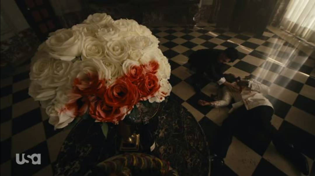 White roses are stained with blood as Chen lies on the floor after slitting his own throat