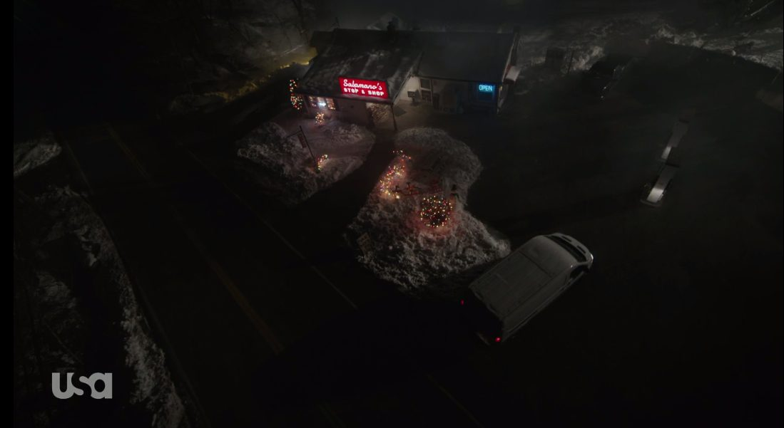 An overhead shot of Salamano's Stop and Shop as the white van arrives