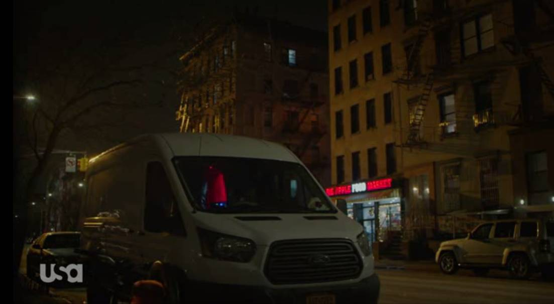 A white van is parked outside of Elliot's apartment