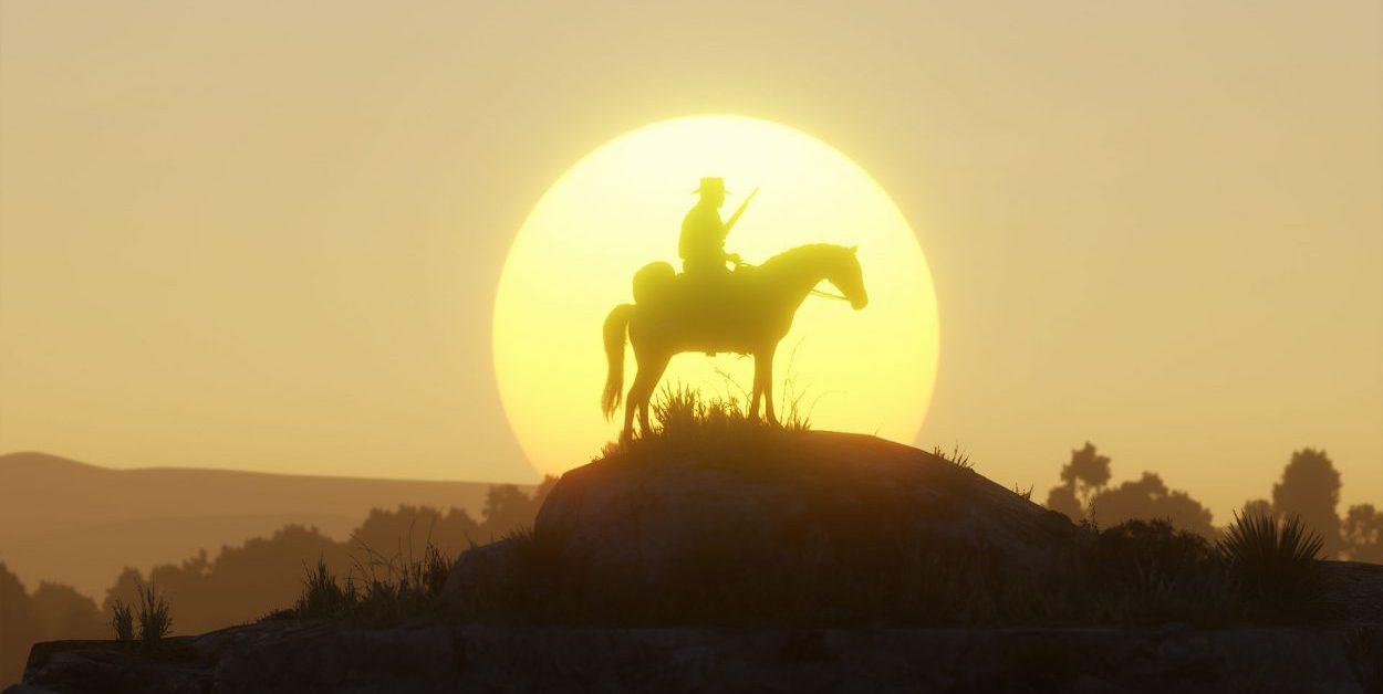 Silhouette of Arthur Morgan on his horse in front of a setting sun