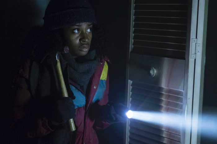 Zohara emerges from the closet in Room 104 holding a hammer and a flashlight