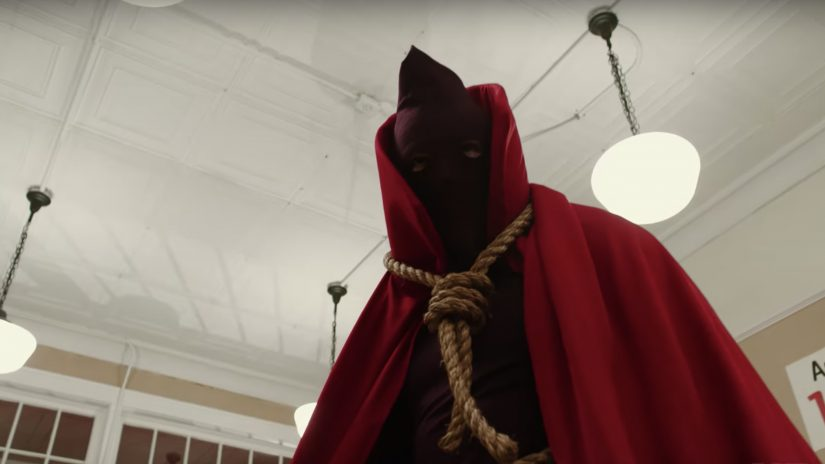 In American Hero Story, the noose-wearing Hooded Justice stands over a thug