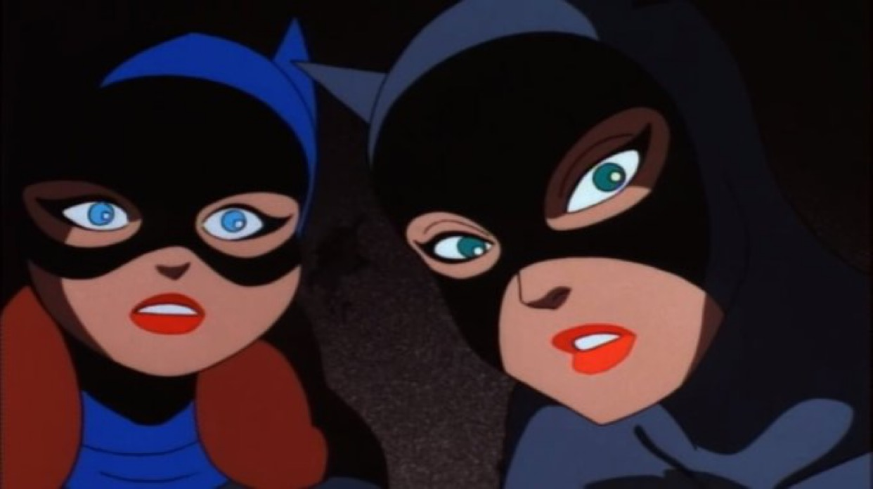A closup on the faces of Batgirl and Catwoman as they try to make sense of what they're seeing.