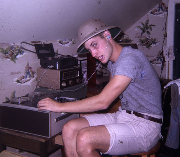 A young Ben Burtt adjusts knobs on a recording device in a bedroom