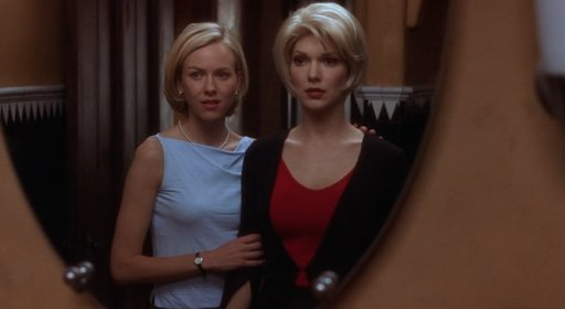 Betty and Rita looking in the mirror as they disguise Rita.