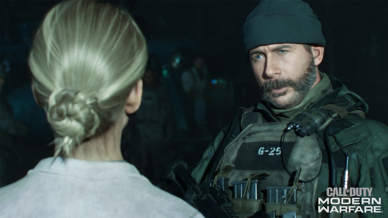 A soldier talks to a blonde woman